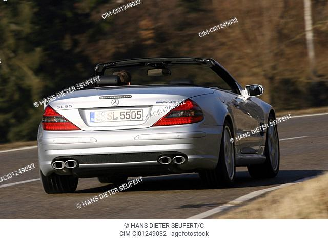 Mercedes SL 55 AMG, model year 2006-, silver, driving, diagonal from the back, rear view, country road, open top