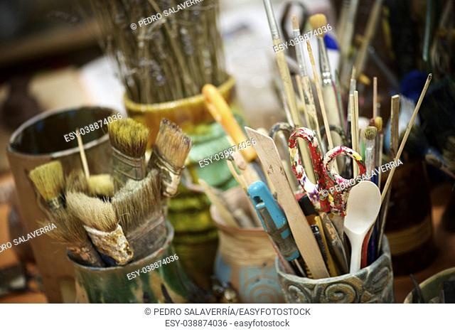 Group of brushes and tools n an artist's workshop