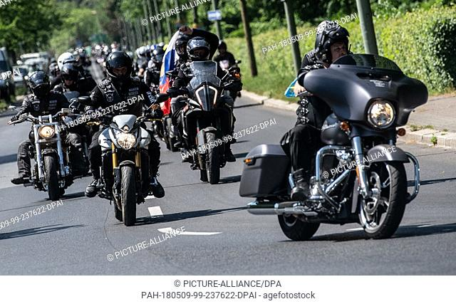 "09 May 2018, Germany, Berlin: Members of the Russian motorcycle gang """"Night Wolves"""" driving through Berlin on """"Victory Day"""""