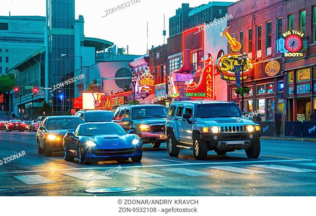 NASHVILLE - AUGUST 28: Downtown Nashville with people in the evening on August 28, 2015 in Nashville, TN. Nashville is the capital of the State of Tennessee and...