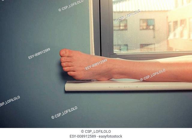 Woman's foot on window sill