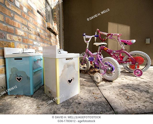 Children's bikes are left in the backyard of a foreclosed home in Covington, Louisiana, United States