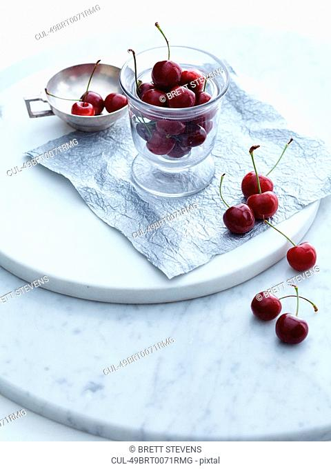 Cup of cherries on tray