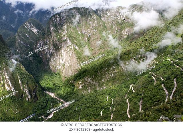 View of the winding road leading to the train des train the archaeological complex of Machu Picchu. Machu Picchu is a city located high in the Andes Mountains...
