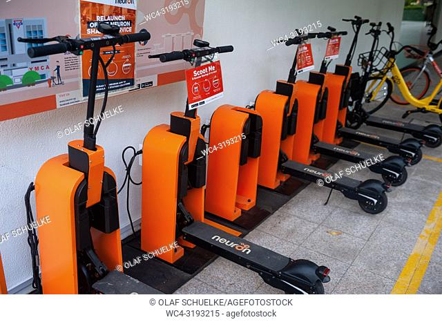 Singapore, Republic of Singapore, Asia - Neuron E-scooters are being charged at a charging point in the city centre. They can be rented for a fee using an app