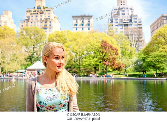 Female tourist in Central Park, New York, USA