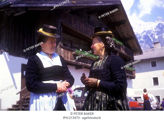 Local women in tradioanl costume taking part in the Corpus Christi Festival being held in the picturesque village of Leogang