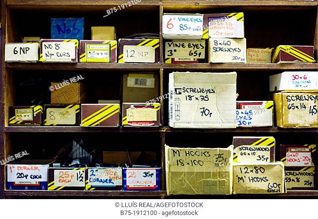 Spotlight shelf with boxes of screws with prices and references in a hardware store Clerkenwell, London, England, UK