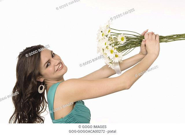 Teenage girl holding bouquet of flowers