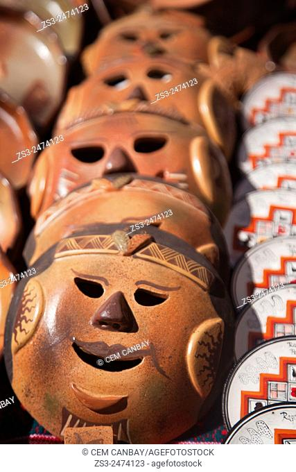 Ceramic masks at the market place in Raqchi town, Puno Region, Peru, South America