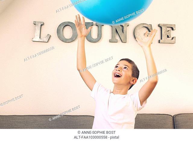 Boy catching large ball