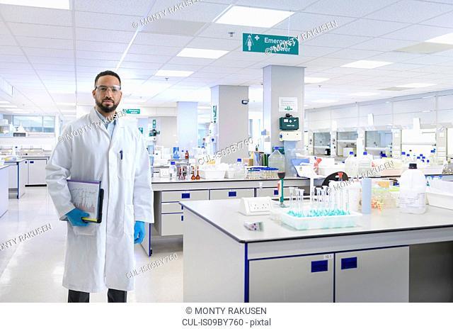 Composite image of male scientist in laboratory