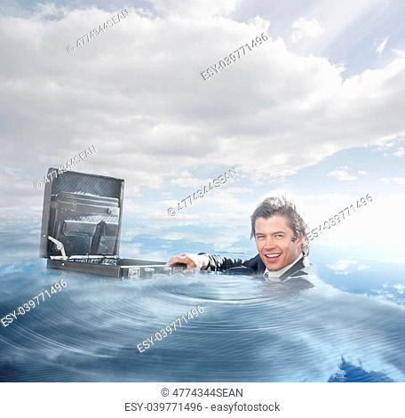 Businessman swimming in the water on a bright sunny day