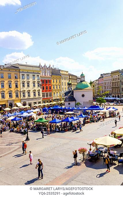 Tourists in the main square in Krakow, old historical city in Poland, Europe