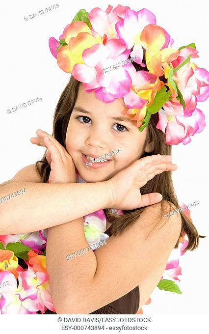 Five year old girl dressed in an Hula Dancers outfit on white background