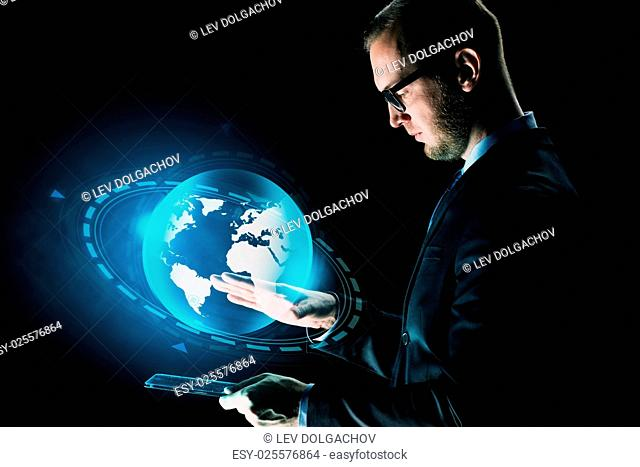 business, people, network, mass media and future technology concept - businessman with tablet pc computer and earth globe hologram over dark background