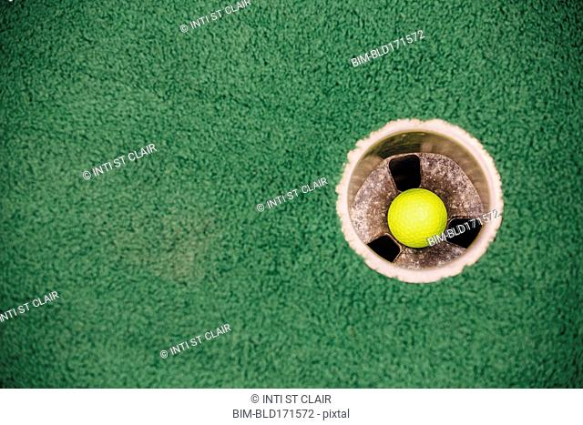 High angle view of golf ball in hole