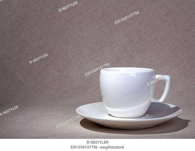 the cup and saucer on a natural fabric