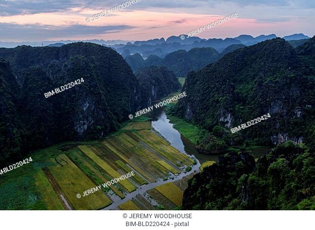 Aerial view of rice paddies and mountains in rural landscape