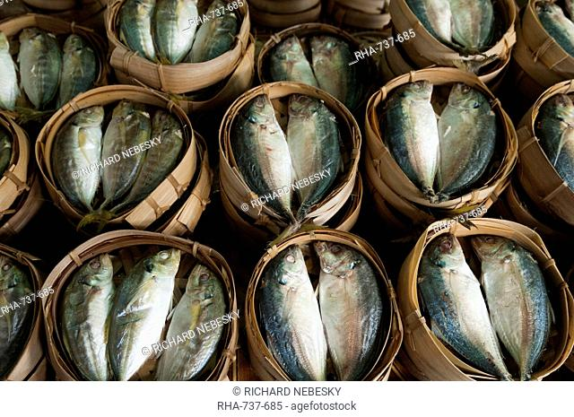 Fish sold in bamboo containers ready for steaming at Talat Thong Khan Kham market, Vientiane, Laos, Indochina, Southeast Asia, Asia