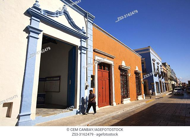 Man in front of the colorful colonial buildings at the historic center, Campeche, Campeche State, Mexico, Central America