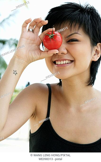young asian woman winking and smiling
