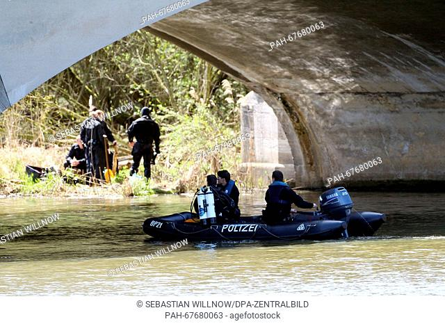 Police divers search for evidence beneath Landauer bridge at the Elster river basin inLeipzig, Germany, 21 April 2016. The mutilated body of a woman was...