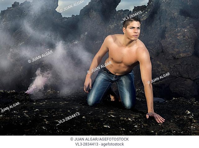 Shirtless man near smoking box