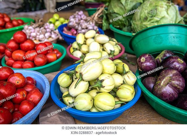 Plastic bowls full of eggplants and tomatoes at outdoor market, Rwanda Farmers Market, in Rwanda