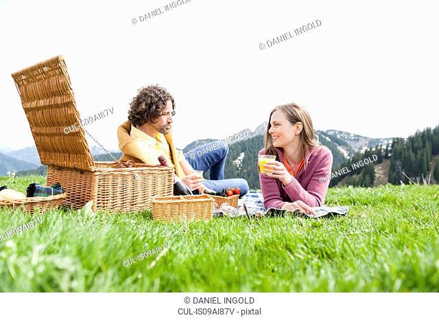 Mid adult couple enjoying picnic, Wallberg, Tegernsee, Bavaria, Germany