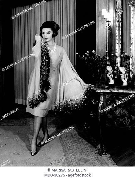 Sylva Koscina wearing an evening dress. Yugoslavian-born Italian actress Sylva Koscina wearing an evening dress by Maria Antonelli. 1963