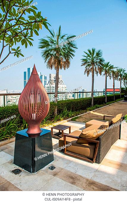 Sofa on roof terrace, Sathorn, Bangkok, Thailand