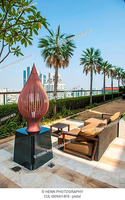 Sofa on roof terrace, Sathorn, Bangkok, Thailand