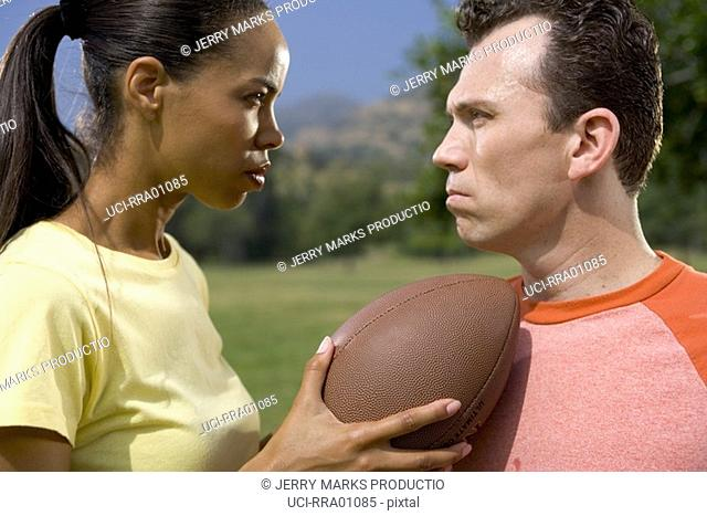 Football opponents glaring at each other