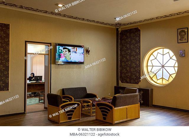 Iran, Central Iran, Yazd, hotel lobby with Iranian TV program
