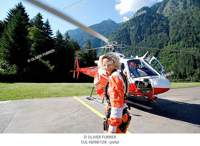 First time female tandem sky diver getting ready for helicopter, Interlaken, Berne, Switzerland