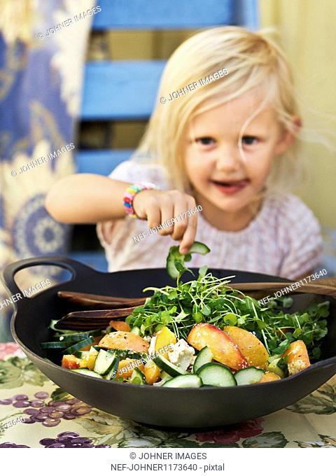 Girl eating salad, portrait, close-up