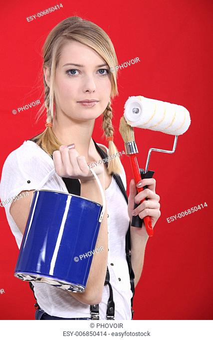Painter holding her supplies