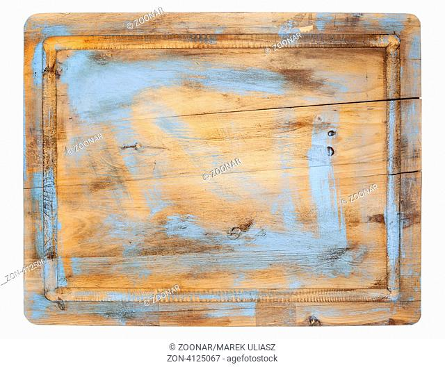 rustic cracked cutting board with grunge blue painting isolated on white