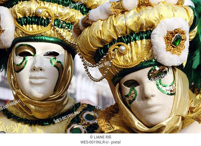 Italy, Venice, masked persons