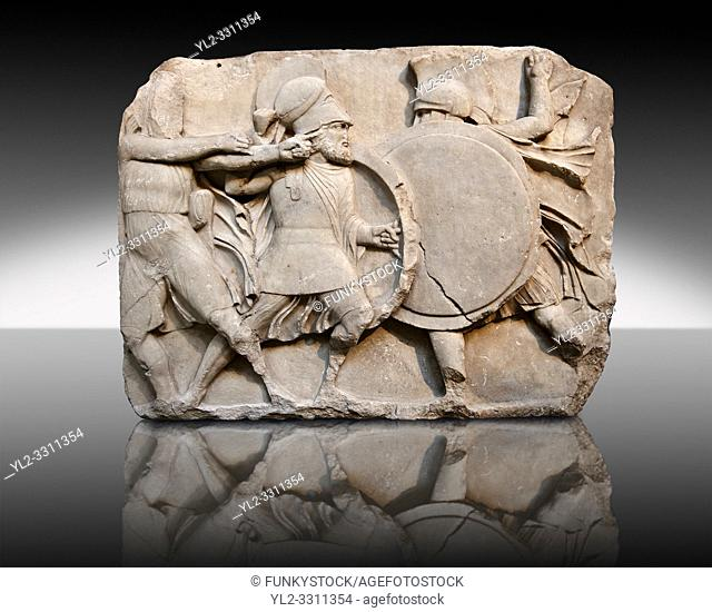 Two warriors clasing shields on a freeze from the Large Podium of the sculptured 4th cent. B. C Lycian Nereid ( Mythical Greek Sea Nymphs) Monument tomb of...