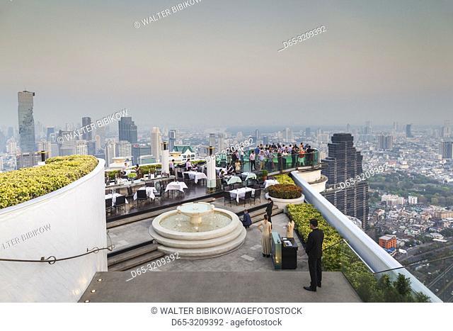 Thailand, Bangkok, Riverside Area, visitors to The Skybar at the Lebua Hotel, dusk, NR
