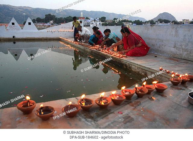 Family celebrating Diwali in Pushkar Lake at Rajasthan India