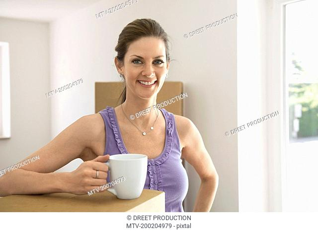 Moving in new apartment woman coffee break