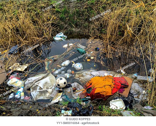 Dunkerque, France. Disposed of garbage dumped in a ditch, near The Jungle, a camp for illiegal migrants bound for the UK
