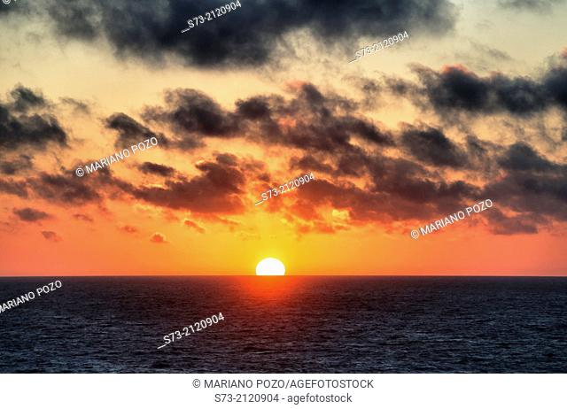Golden orange sunset with sun in Mediterranean, Spain