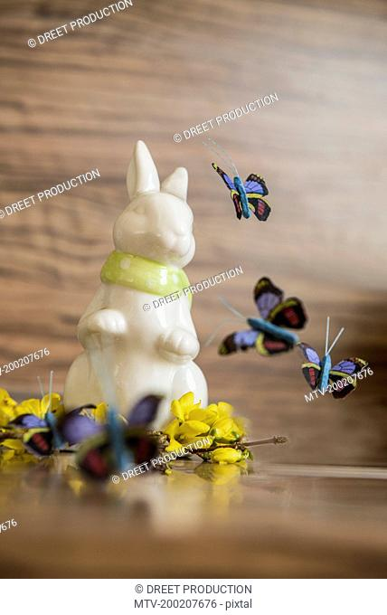 Close-up of Easter bunny with artificial butterflies