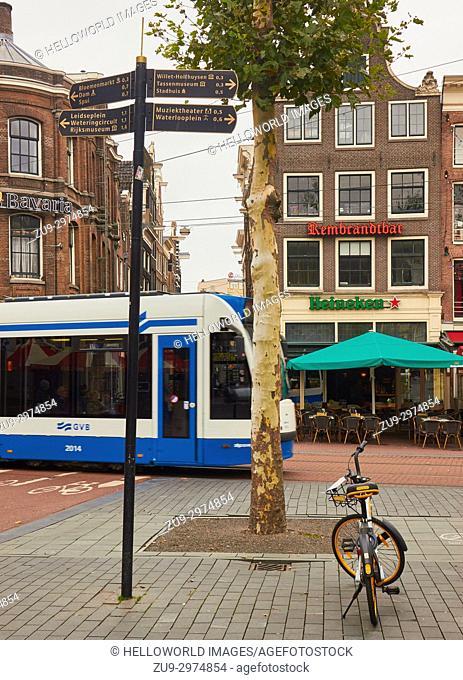 Tourist direction signs and tram, Nieuwmarkt, Amsterdam, Netherlands