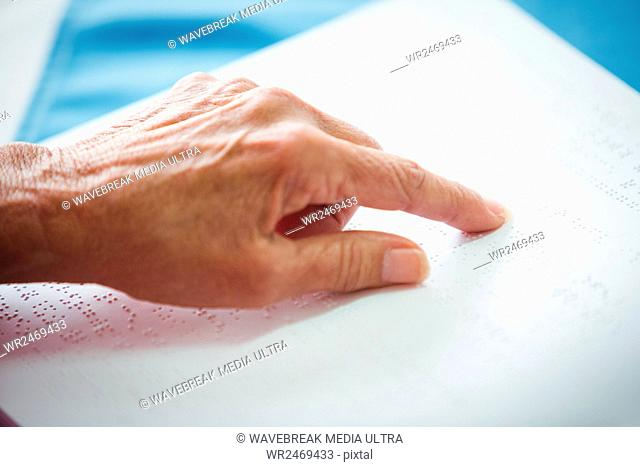 Close-up of two pointing hand on a book
