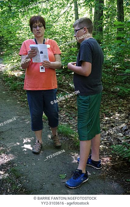 Teacher Looking at Brochure With Student, Rock City Park, Olean, New York, USA